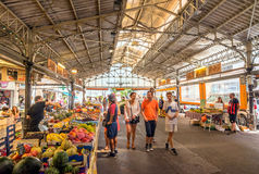 Cours Massena provencal market in the old town, Antibes. Antibes, France - June 29, 2016: day view of Cours Massena provencal market with tourists in Antibes stock photos