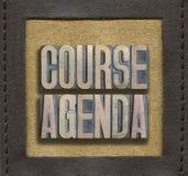 Course agenda framed. COURSE AGENDA phrase assembled from vintage wooden letterpress inside stitched leather frame Royalty Free Stock Images