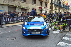 Course Car Road Cycling Race. The Race Diector in his car leads the peleton at the the start of the stage in the narrow streets of Alicante during the 2017 La Royalty Free Stock Photography