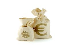 Course of currency. Bags with money. Dollar is smaller and euro larger stock photos
