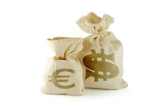Course of currency. Bags with money. Dollar is smaller and euro larger stock photo