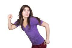 Course de femme de brune effrayée Photographie stock libre de droits