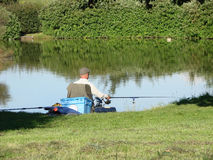Course fishing. A man course fishing using a rod and reel Royalty Free Stock Photo