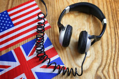 Course language headphone and flag on a table Royalty Free Stock Photos