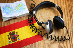 Course language headphone and flag on a table Stock Image