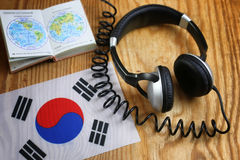 Course language headphone and flag on a table Stock Photography