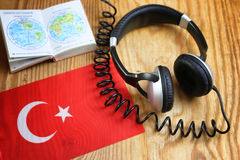 Course language headphone and flag on a table Stock Photos
