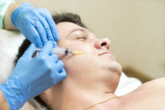 Course of mesotherapy clinic. Man passes a course of mesotherapy clinic Royalty Free Stock Photography