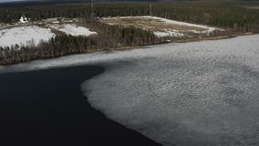 The course of the river smoothly blurs thick ice in the spring flood
