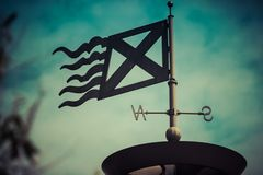 The course of the wind, metal construction, weathercock, metal flag, wind direction. The course of the wind, metal construction, weathercock, metal flag stock photography