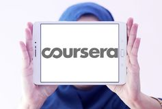 Coursera online education logo. Logo of Coursera on samsung tablet holded by arab muslim woman. Coursera is a venture backed, education focused technology stock images