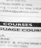 Courses. Word courses focused in newspaper. Other text is blurred Royalty Free Stock Images