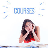Courses against stressed student at desk Stock Images