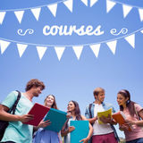 Courses against students standing and chatting together Stock Images
