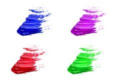 Courses colorées de brosse sur un fond blanc Image stock
