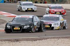 Courses d'automobiles (Timo Scheider, DTMrace) Photographie stock