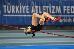 Courses d'intérieur de tentative de disque d'athlétisme Photographie stock