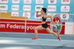 Courses d'intérieur de tentative de disque d'athlétisme Photo libre de droits
