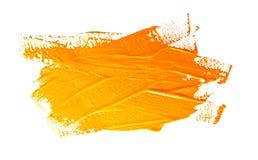 Courses d'ocre jaune du pinceau d'isolement image libre de droits