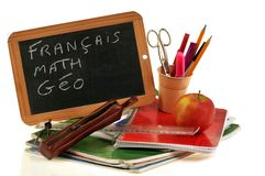 Courses written in french on a school slate royalty free stock photos