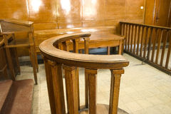 Court bench close-up. Wooden court bench. Vintage style court room close up royalty free stock photo