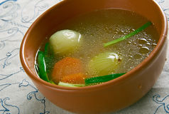 Court bouillon. Court-bouillon  flavored liquid for poaching or quick-cooking foods Royalty Free Stock Photos