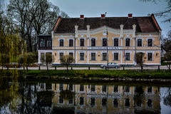 Court building in Kuldiga, Latvia. Nice renovated court building in the old historic town of Kuldiga, Latvia reflecting in the pond. Beautiful blue skies, no Stock Photos