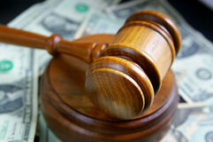 Court cash. Closeup of a court gavel on cash Royalty Free Stock Photography