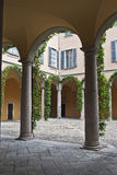 Court colonnade with ivy. Colonnade in old italian court with green ivy Royalty Free Stock Photos