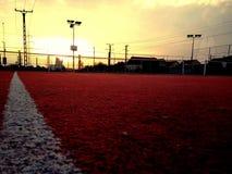 Court de tennis de coucher du soleil Photo libre de droits