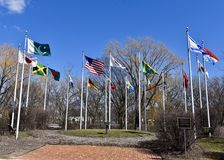 Court of Flags. This is an early Spring picture of the Court of Flags on display at the Skokie Northshore Sculpture Park located in Skokie, Illinois in Cook Royalty Free Stock Photography