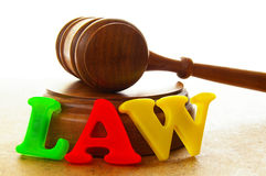 Court gavel. With play letters spelling law Stock Image
