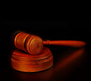 Court gavel. On a dark background Royalty Free Stock Images