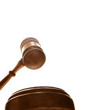 Court gavel. Judges court gavel from below, on white Stock Photography