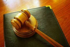 Court gavel. Legal gavel and leather binder on a desk Stock Photography