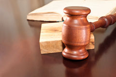 Court. Gavel and a book lying on a table Stock Image