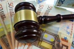 Court gavel on Euros. Court gavel on Euro notes Stock Image