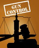 Gavel and gun control stock photo