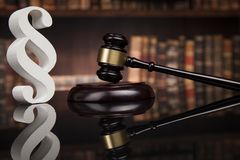 Court gavel,Law theme, mallet of justice, Paragraph, mirror back. Paragraph, law and justice concept, wooden gavel, mirror background royalty free stock image