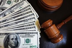 Court gavel. Legal court gavel on assorted cash Royalty Free Stock Photos
