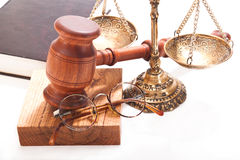 Court. Gavel, scales of justice, glasses, a book on a white background Royalty Free Stock Images