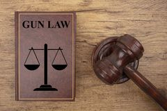 Court Hammer with Gun Law Book royalty free stock photo