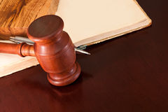 The court hearing. Gavel, book and pen on a lacquered table in the courtroom Stock Photos