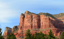 Court House Rock Sedona. Sedona is built in an area surrounded by strikingly beautiful red rock formations. The structures have features associated with familar Royalty Free Stock Image