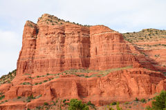 Court House Rock(2) Sedona. Sedona is built in an area surrounded by strikingly beautiful red rock formations. The structures have features associated with Royalty Free Stock Image