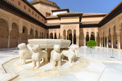 Famous Lion Fountain, Alhambra Castle (Granada, Spain). The Court of Lions at the 13th century Alhambra Palace in Granada Spain. Beautiful arches and Arabesque Stock Photography