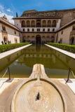 Court of the Myrtles in La Alhambra, Granada. Granada, Spain - May 19, 2014: The courtyard of the Myrtles Patio de los Arrayanes in La Alhambra, Granada, Spain stock images
