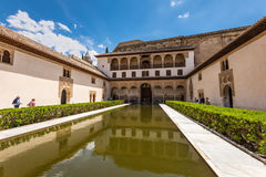 Court of the Myrtles in La Alhambra, Granada. Granada, Spain - May 19, 2014: Tourists in the courtyard of the Myrtles Patio de los Arrayanes in La Alhambra royalty free stock images