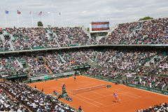 Court Philippe Chatrier at Le Stade Roland Garros during Roland Garros 2015 match. PARIS, FRANCE- MAY 29, 2015: Court Philippe Chatrier at Le Stade Roland Garros Royalty Free Stock Images