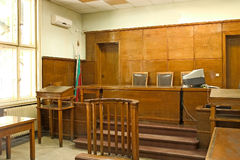 Court room. Old vintage wooden court room with judge chairs and a witness stand stock photo